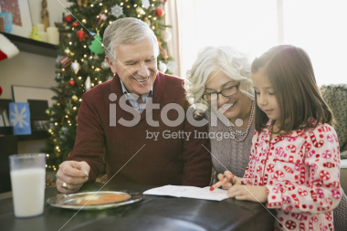 stock-photo-39856824-grandparents-helping-girl-write-letter-to-santa-claus